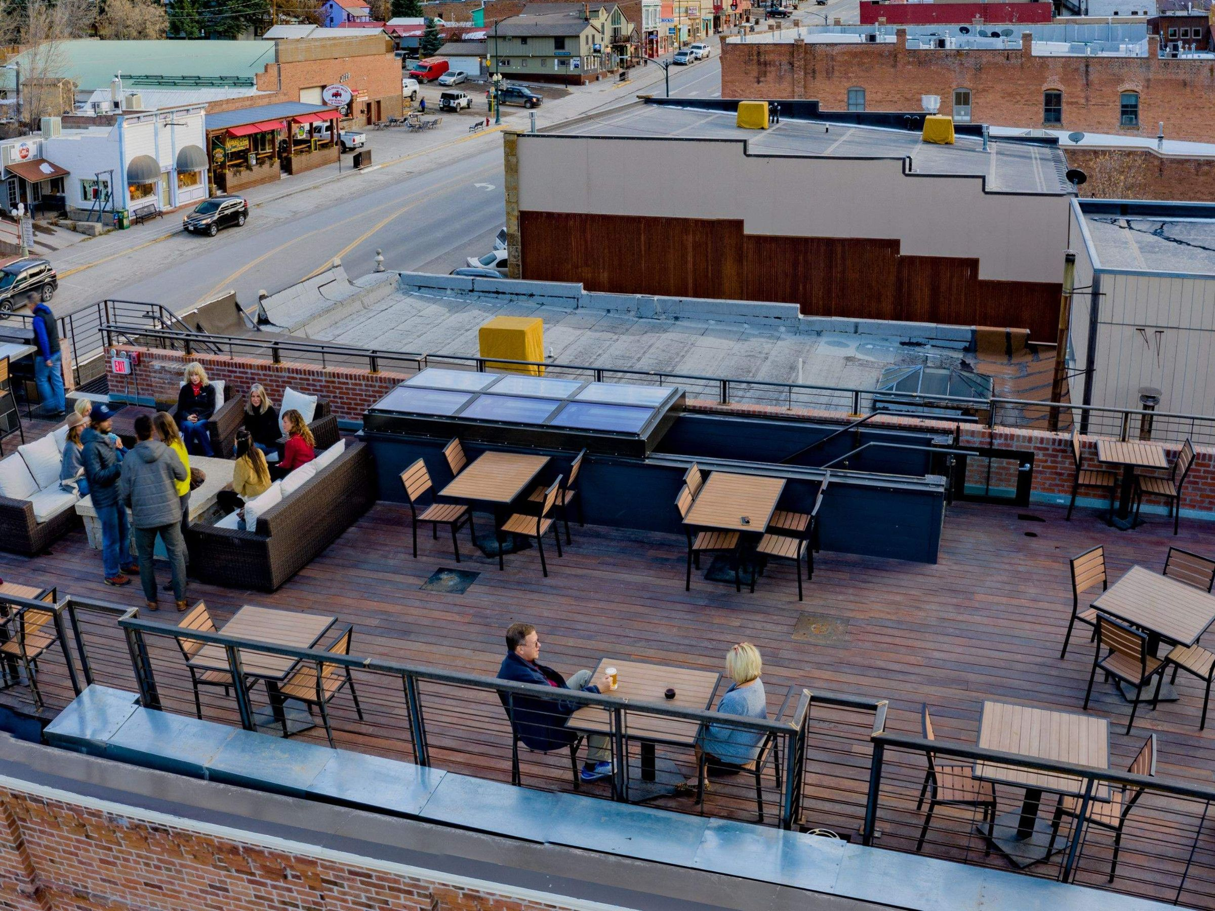 Retractable roof access rooftop bar